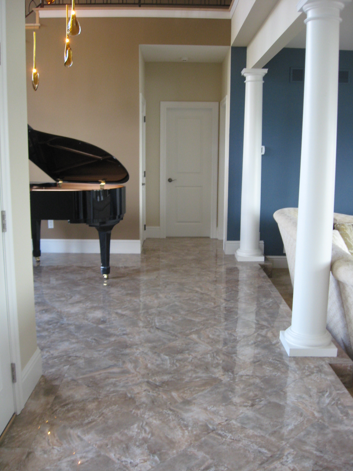Tile that looks like marble - Breathtaking Entrance With Porcelain Tile That Looks Like Polished Marble Used For Durability And Ease Of Care