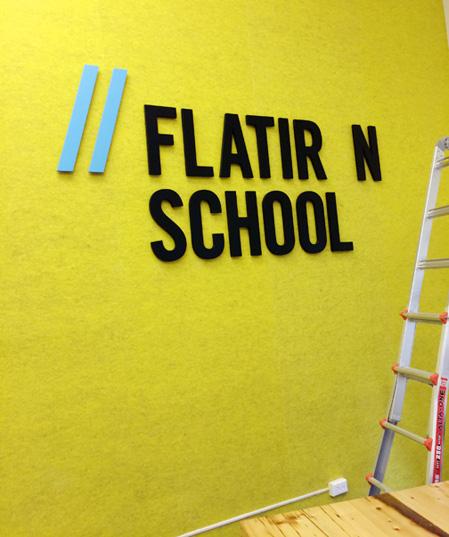 Axiom Signs NYC - Vinyl and MDF signage installs, Flatiron