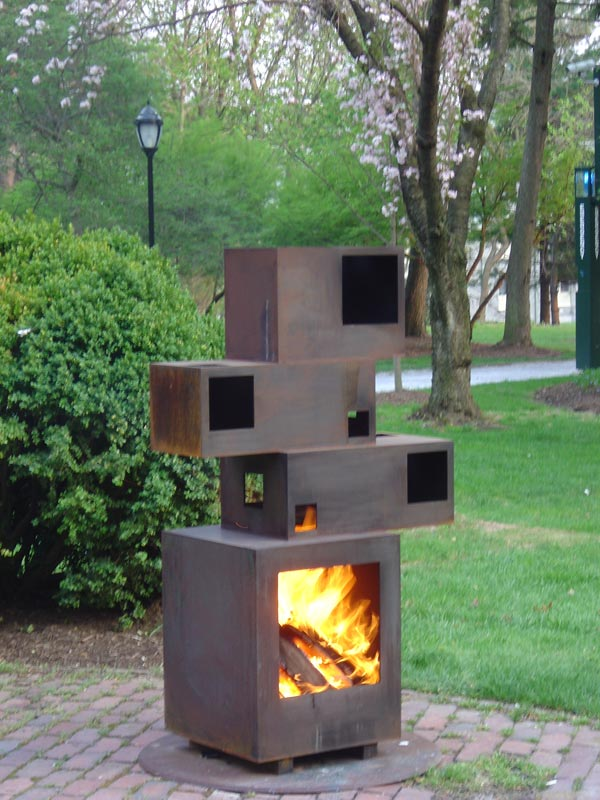 Lit Prometheus Is An Outdoor Fireplace Composed Of Corten Steel The Fluidity Fire Contrasts With Sculptural Hardness Structure